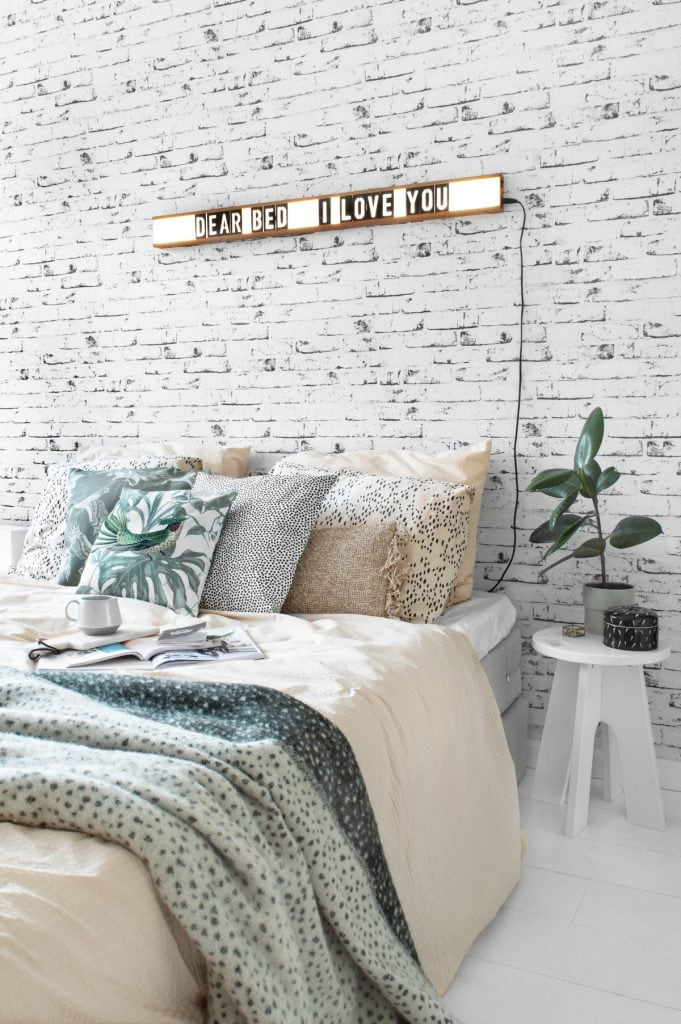 Bedroom lightbox crisp sheets brick wall - Tanja van Hoogdalem