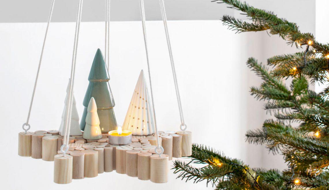 Kerst DIY: een hangende ster van houten stokken
